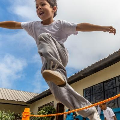 A child participates in a sports day during our volunteer sports coaching in Ecuador